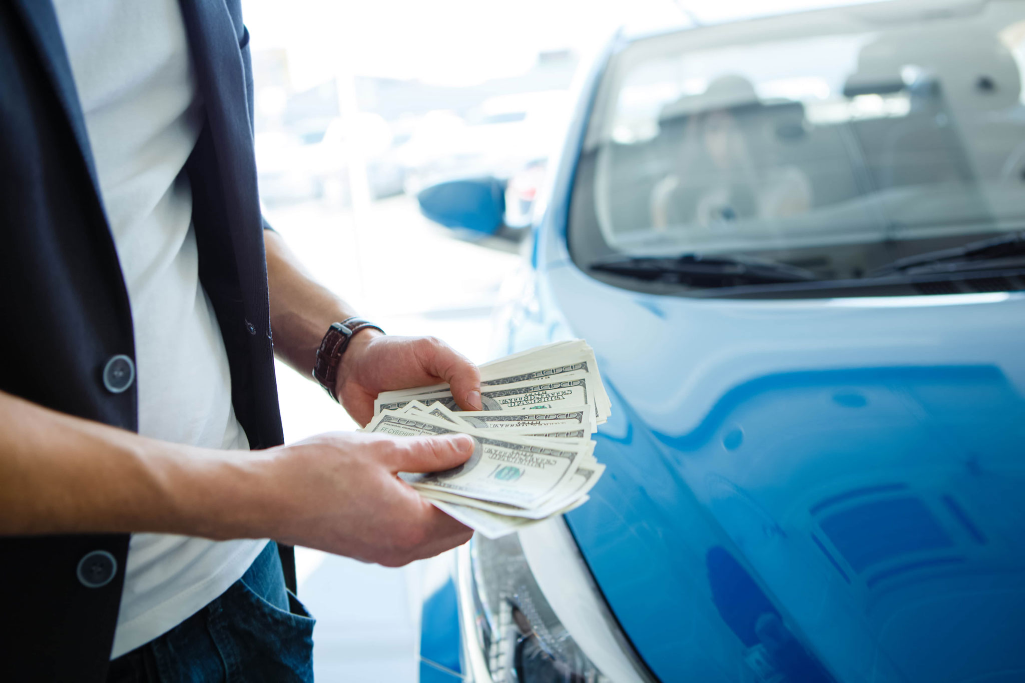Depositphotos 79146564 Xl 2015 Man Cash Money Infront Of Car Min